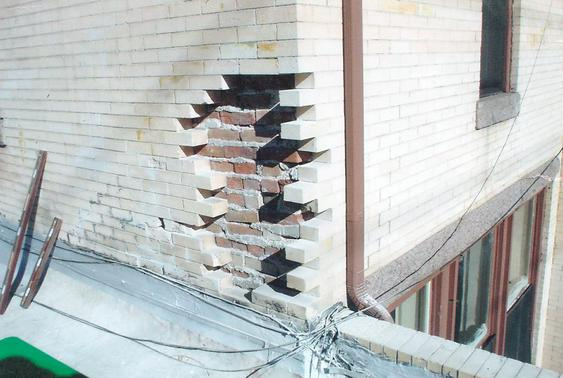 Eroding brick due to water damage, brick replacement to fix during_brick_tear_down_2_jpg