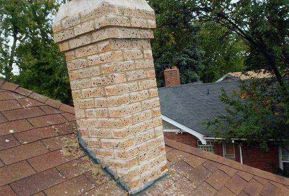 Grind Out All Mortar Joints, Tuck Point Chimney during_chimney_repointing_job_11_jpg