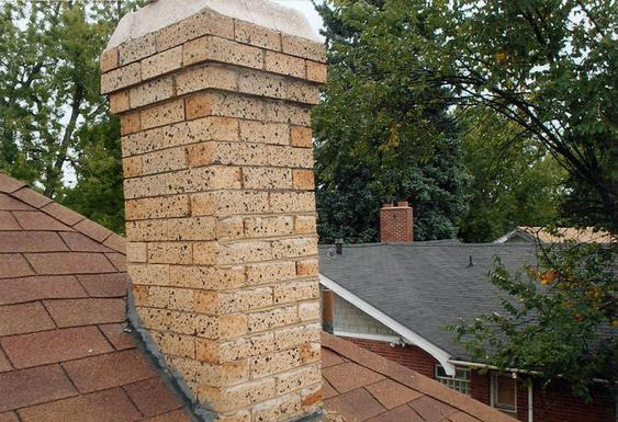 Grind Out All Mortar Joints, Tuck Point Chimney during_tuckpointing_on_chimney_in_denver_11_jpg