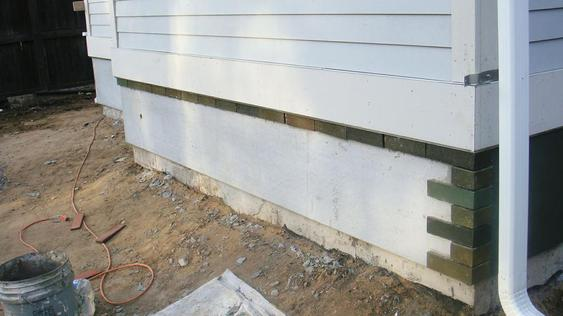 Installing Thin Brick on Back Addition of House during_1_33_jpg