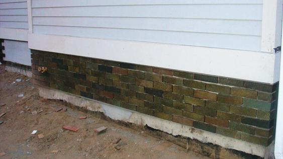 Installing Thin Brick on Back Addition of House during_3_33_jpg