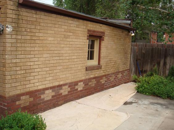 Rebuild Both Courses of Garage Wall to Plumb before_bowed_out_garage_wall_25_jpg