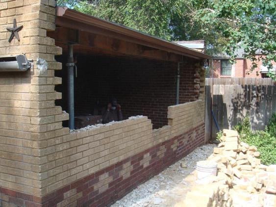 Rebuild Both Courses of Garage Wall to Plumb during_2_25_jpg