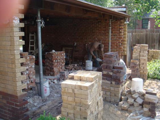 Rebuild Both Courses of Garage Wall to Plumb during_3_25_jpg