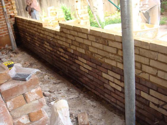 Rebuild Both Courses of Garage Wall to Plumb during_4_25_jpg