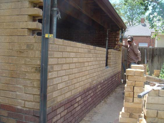 Rebuild Both Courses of Garage Wall to Plumb during_5_25_jpg