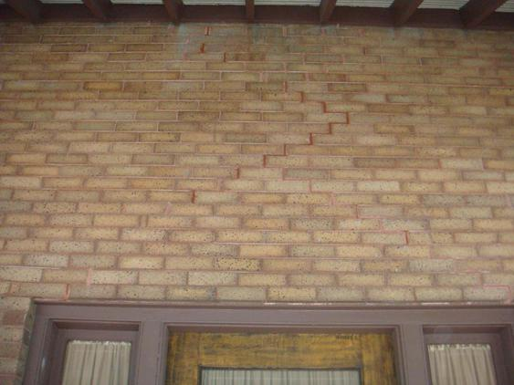 Rebuild Porch Wall, Re-lay Loose Bricks and Stone, Tuckpoint Deteriorating Mortar before_1_24_jpg