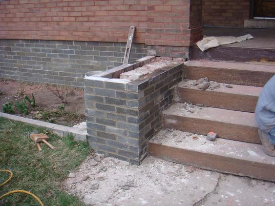 Rebuild Porch Wall, Re-lay Loose Bricks and Stone, Tuckpoint Deteriorating Mortar during_2_24_jpg