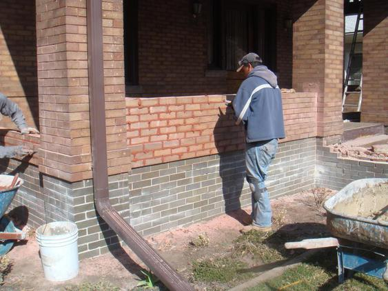 Rebuild Porch Wall, Re-lay Loose Bricks and Stone, Tuckpoint Deteriorating Mortar during_4_24_jpg