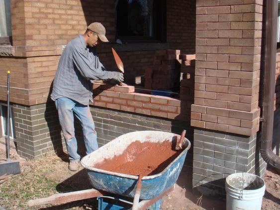 Rebuild Porch Wall, Re-lay Loose Bricks and Stone, Tuckpoint Deteriorating Mortar during_5_24_jpg