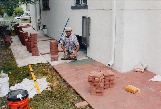 Re-lay Pavers Over Concrete Walkway during_brick_repaving_work_3_jpg