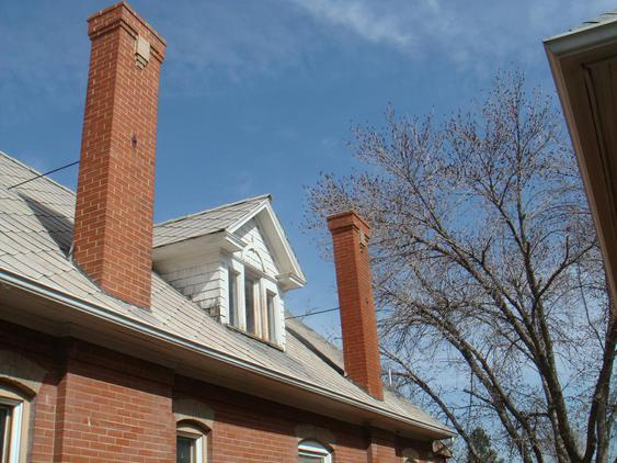 Tuckpoint All Joints On Both Chimneys and Rebuild Top 10 Courses after_2_16_jpg